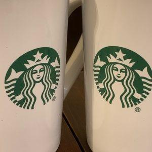A pair of Starbucks Mermaid mugs
